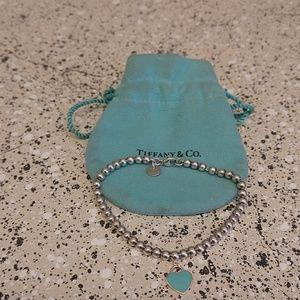 Beaded Tiffany bracelet with small charm.